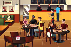 Young people eating pizza together in a restaurant. A vector illustration of young people eating pizza together in a restaurant Stock Photo