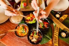 Young people eating in Thai restaurant royalty free stock photos