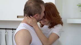 Young people embrace in kitchen stock footage