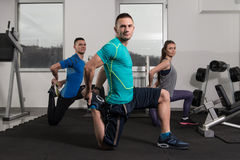 Young People Engaged In The Gym Royalty Free Stock Photo