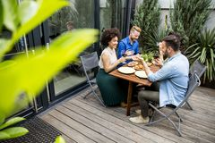 Young people enjoy the food and drink and have great fun outdoor. S in backyard stock images