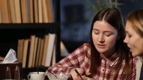 Young people enjoying coffee break and chatting Stock Image