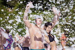 Young people enjoying  a foam party on the beach Royalty Free Stock Photos