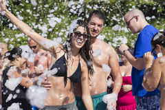 Young people enjoying  a foam party on the beach Stock Images