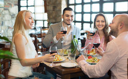 Young people enjoying food at tavern Royalty Free Stock Photo