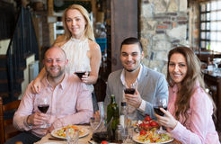 Young people enjoying food at tavern Royalty Free Stock Photo