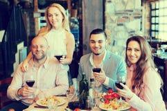 Young people enjoying food at tavern Stock Image