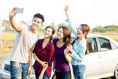 Young  people enjoying road trip  and making selfie Stock Images