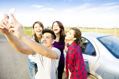 Young  people enjoying road trip  and making selfie Royalty Free Stock Photos