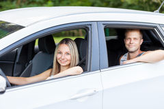 Young people enjoying a roadtrip in the car Royalty Free Stock Photos