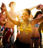 Young people enjoying a summer beach party Stock Image
