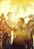 Young People Enjoying a Summer Beach Party Stock Photo