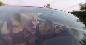 Young people enjoying summer holiday driving in convertible stock video