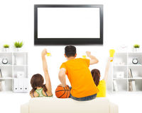 Young people so excited to yelling and while watching tv Stock Image
