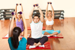 Young people exercising with dumbbells Stock Photo