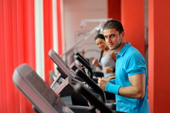 Young people exercising in the gym Royalty Free Stock Photo