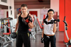 Young people exercising in the gym Stock Images