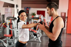 Young people exercising in the gym Royalty Free Stock Images