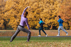 Young people exercising in park Stock Photos