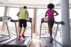 People exercisinng a cardio on treadmill in gym Stock Photos