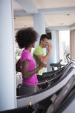 People exercisinng a cardio on treadmill in gym Royalty Free Stock Photos