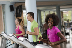 People exercisinng a cardio on treadmill in gym Royalty Free Stock Photography