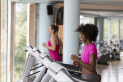 People exercisinng a cardio on treadmill in gym Stock Photo