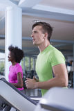 People exercisinng a cardio on treadmill in gym Royalty Free Stock Image