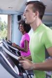 People exercisinng a cardio on treadmill Stock Photos