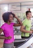 People exercisinng a cardio on treadmill Stock Photo