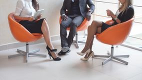 Young people expect interviews sitting on chairs in an office building. the interview for the job. Royalty Free Stock Photo