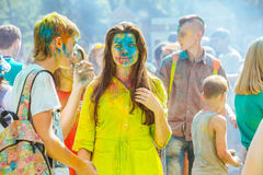 Young people with face smeared with colors. Concept for festival Stock Images