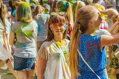 Young people with face smeared with colors. Concept for festival Stock Image