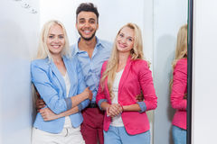 Young People Fashion Shop Fitting Room Shopping, Happy Smiling Woman And Man Trying New Clothes Stock Photos