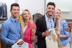 Young People Fashion Shop, Happy Smiling Man And Woman Hold Credit Card Shopping. In Retail Store Royalty Free Stock Image
