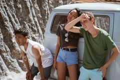 Young people feeling tired on the back the broke down car. Young people feeling tired on the street side back the broke down car royalty free stock photos