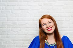 Facial Expressions Of Young Redhead Woman On Brick Wall Royalty Free Stock Images