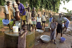 Young people fetch water at a water pump. Ghana, Techiman city: even in this town is in the homes of poor Ghanaians no running water, drinking water. Have to royalty free stock photography