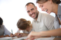 Young people filling forms in business training Royalty Free Stock Photos