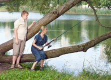 Young people on fishing. Portrait in a sunny day Royalty Free Stock Image