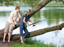 Young people on fishing Stock Image