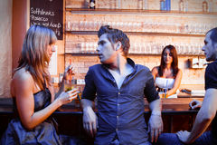 Young People Flirting At The Bar Stock Image