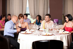 Young people flirting restaurant table. Happy young couples talking restaurant table Stock Photos