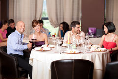 Young people flirting restaurant table Royalty Free Stock Image