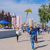 Young people flying kites during City Day local activity Royalty Free Stock Images