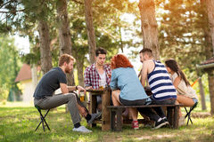 Young people in forest plays chess Stock Photo