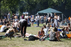 Young people are fried kebabs and rest in a local park London fields in Hackney Stock Image