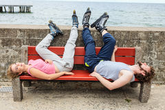 Young people friends relaxing on bench. Royalty Free Stock Image
