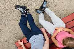 Young people friends relaxing on bench. Stock Photography