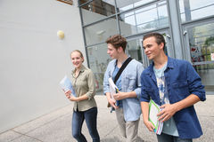 Young people in front of campus Royalty Free Stock Photography